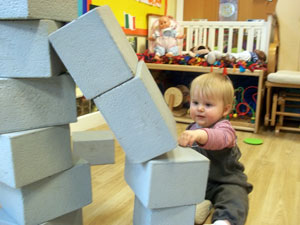 Child building a tower out of foam bricks